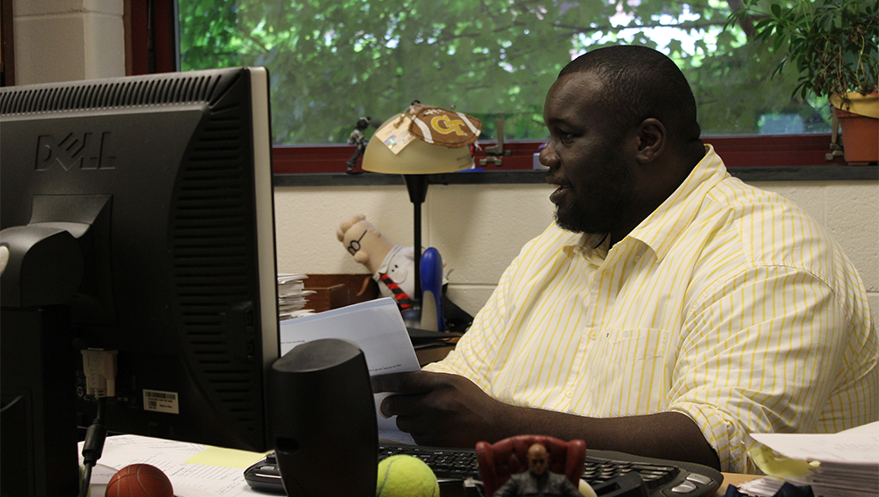 GT staff member working at his desk in his office.